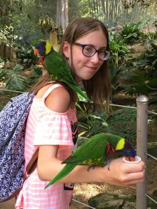Emma holding a parrot