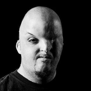 Lars looks at the camera in a black and white shot